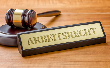 Photo pour A gavel and a name plate with the german engraving Arbeitsrecht  (Labor Law) - image libre de droit