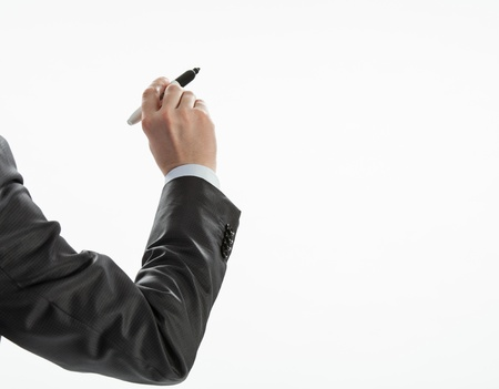Businessman's hand writing something on a white wall