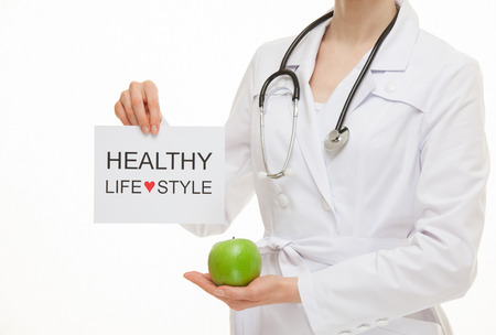 Photo pour Doctor calling to healthy lifestyle , white background - image libre de droit