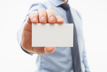 Photo pour Unrecognizable businessman showing business card - closeup shot - image libre de droit