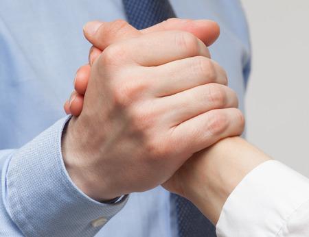 Foto de Businessmen's hands demonstrating a gesture of a strife or solidarity, white background - Imagen libre de derechos