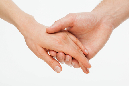 Photo for Man's hand gently holding woman's hand - closeup shot - Royalty Free Image