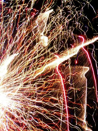 Foto de Sparks of festive banger at night - Imagen libre de derechos