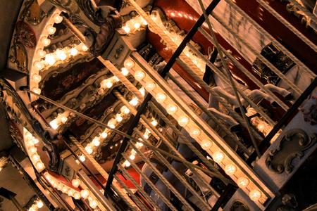 Foto de Evening illumination of merry-go-around by bulbs - Imagen libre de derechos