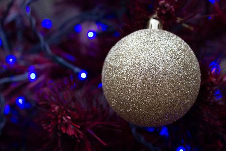 Foto de New-year decorative ball on a background a christmas tree - Imagen libre de derechos