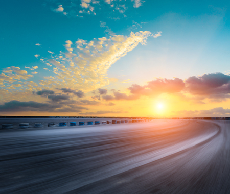 Photo for Motion blur asphalt road circuit and beautiful sky clouds at sunset - Royalty Free Image