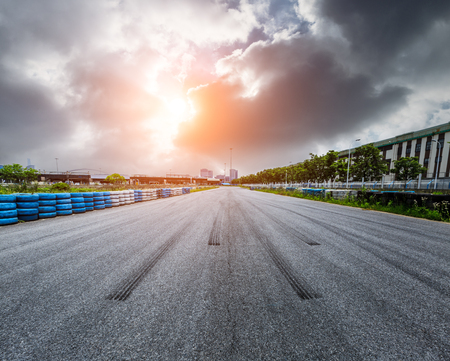Photo pour Asphalt road circuit and sky sunset with car tire brake - image libre de droit