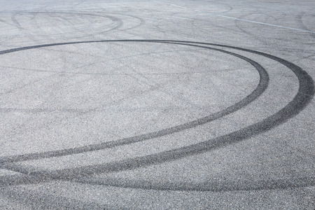 Photo pour Abstract background black tire tracks skid on asphalt road, high angle shot view in racing circuit - image libre de droit