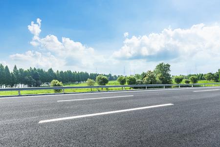 Photo pour country asphalt road and green trees nature landscape in the summer - image libre de droit