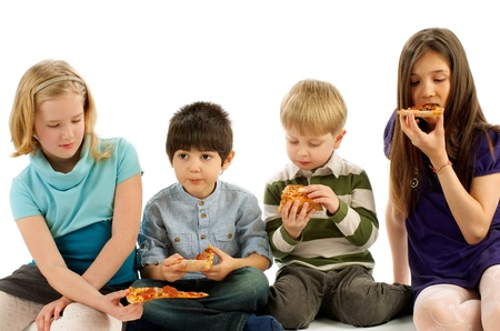 Two Boys and Two Girls Eating Pizza isolated on white background