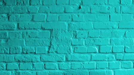 Foto de Background of Brick Wall Painted with Mortar Turquoise Color closeup - Imagen libre de derechos