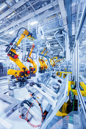 Photo for robotic arms in a car plant - Royalty Free Image