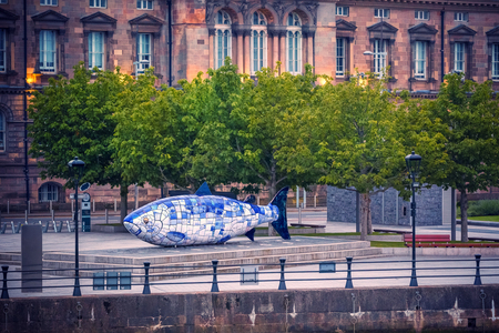 Photo for The Big Fish is a printed ceramic mosaic sculpture in Belfast also known as The Salmon of Knowledge. The work celebrates the regeneration of the Lagan River. - Royalty Free Image