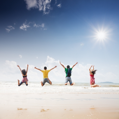 Photo for friends jumping on beach - Royalty Free Image