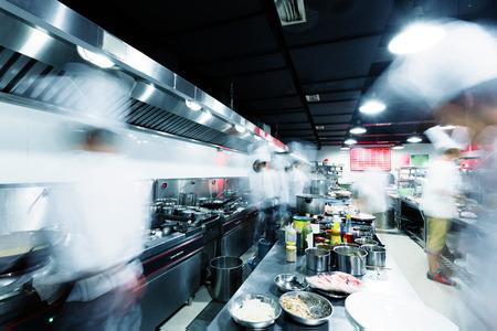 Foto de Modern kitchen and busy chefs in hotel - Imagen libre de derechos