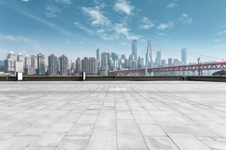 Foto per modern skyline and empty road - Immagine Royalty Free