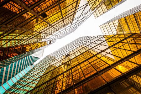 Foto de low angle view of modern skyscraper exterior and sky in modern city - Imagen libre de derechos