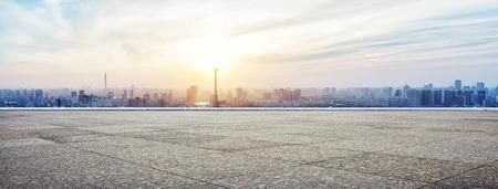 Photo pour Panoramic skyline and buildings with empty concrete square floor - image libre de droit