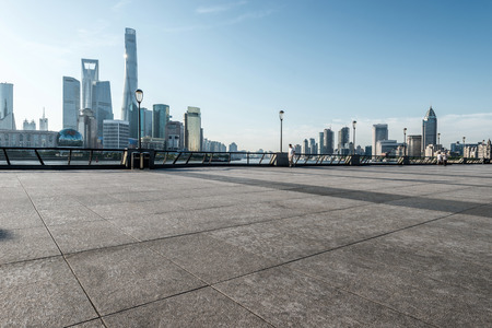 Foto de panoramic skyline of shanghai with empty street floor - Imagen libre de derechos