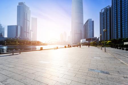 Photo pour Modern skyline and empty road floor - image libre de droit