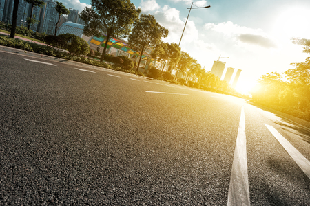 Photo pour empty asphalt road with trees under sunshine - image libre de droit