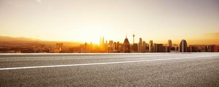 Photo pour empty asphalt road and cityscape of kuala lumpur at sunrise - image libre de droit