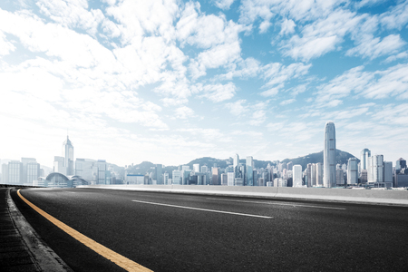 Photo pour empty asphalt road and cityscape of hong kong in blue cloud sky - image libre de droit