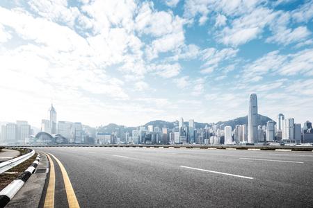 Photo pour empty asphalt road and cityscape of hong kong in blue cloud sky - image libre de droit
