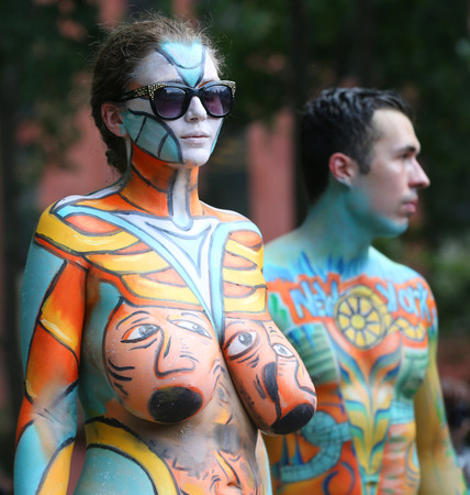 Photo for NEW YORK - JULY 14, 2018: Artists paint  fully nude models of all shapes and sizes during 5th NYC Body Painting Day featuring artist Andy Golub on Washington Square in New York - Royalty Free Image