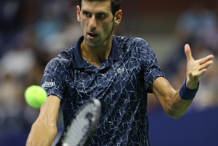 Photo pour NEW YORK - SEPTEMBER 5, 2018: 13-time Grand Slam champion Novak Djokovic of Serbia in action during his 2018 US Open quarter-final match at Billie Jean King National Tennis Center - image libre de droit