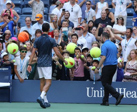 Photo pour NEW YORK - SEPTEMBER 3, 2018: 13-time Grand Slam champion Novak Djokovic of Serbia signs autographs after his 2018 US Open round of 16 match at Billie Jean King National Tennis Center - image libre de droit