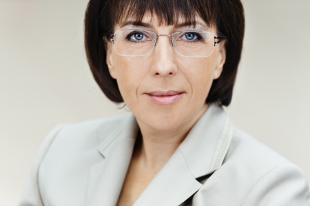 Portrait business woman aged glasses white background