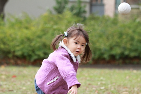 Photo for Japanese girl (3 years old) playing catch - Royalty Free Image
