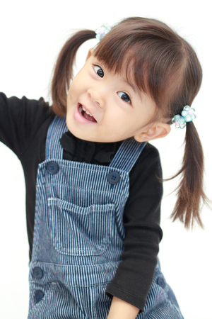 Photo for smiling Japanese girl (3 years old) (white back) - Royalty Free Image