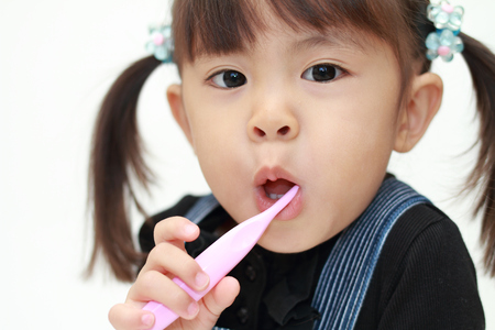 Photo for Japanese girl brushing her teeth (3 years old) - Royalty Free Image