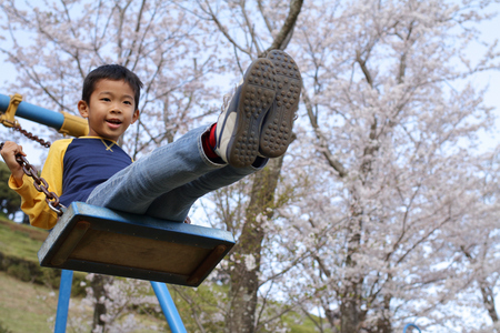 Japanese boy on the swing (third grade at elementary school)