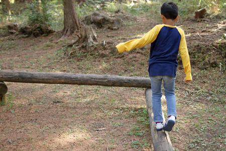 Japanese boy on the balance beam (third grade at elementary school)