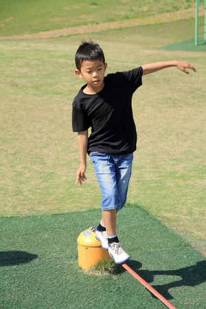 Photo for Japanese boy on the balance beam (third grade at elementary school) - Royalty Free Image