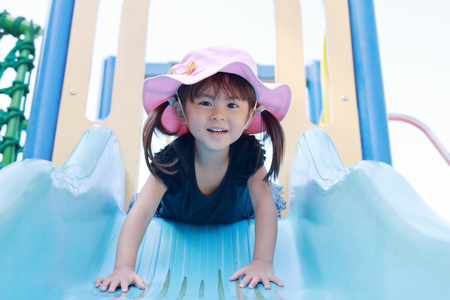 Photo for Japanese girl on the slide (3 years old) - Royalty Free Image