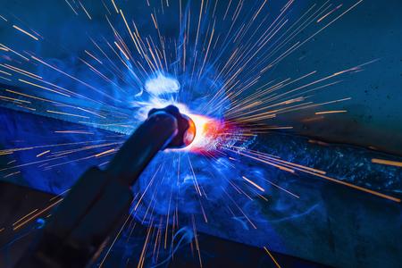 Foto de welder, craftsman, erecting technical steel Industrial steel welder in factory - Imagen libre de derechos