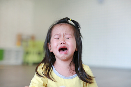 Photo pour Close up Little kid girl crying with tearful on her face. - image libre de droit