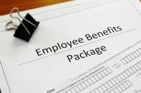 Photo pour Closeup of an employee benefit package  - image libre de droit
