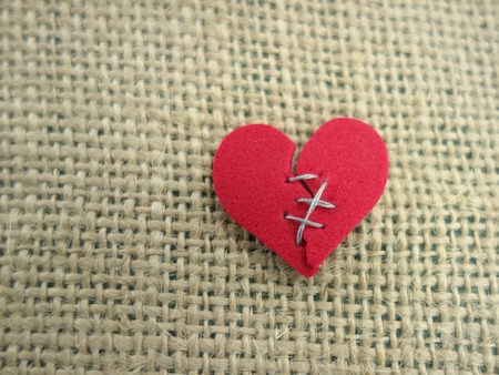 Photo for Red broken heart stitched with thread - Royalty Free Image