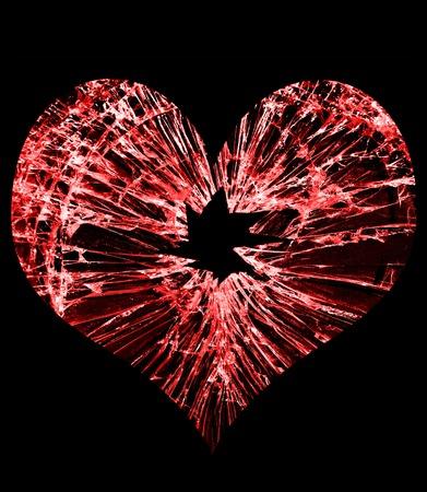 Foto de red heart shaped glass with a hole in the middle - Imagen libre de derechos