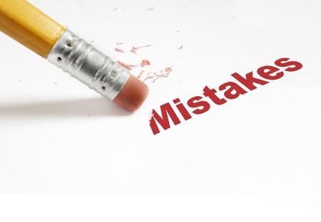 Photo pour closeup of pencil eraser and red Mistakes text - image libre de droit
