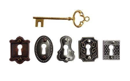 Foto de Assorted antique locks with gold key, isolated on white - Imagen libre de derechos