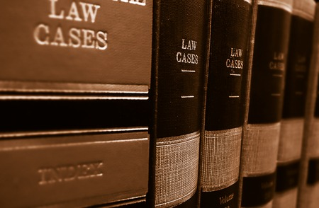 Photo for Law cases and law books on a shelf - Royalty Free Image
