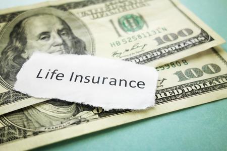 Photo pour Paper scrap with Life Insurance text on cash - image libre de droit