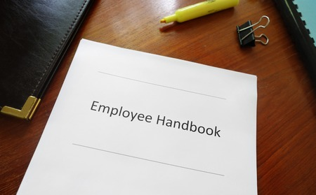 Photo for Employee handbook document on an office desk - Royalty Free Image