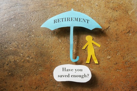 Foto de Retirement umbrella with Have you saved enough text - Imagen libre de derechos
